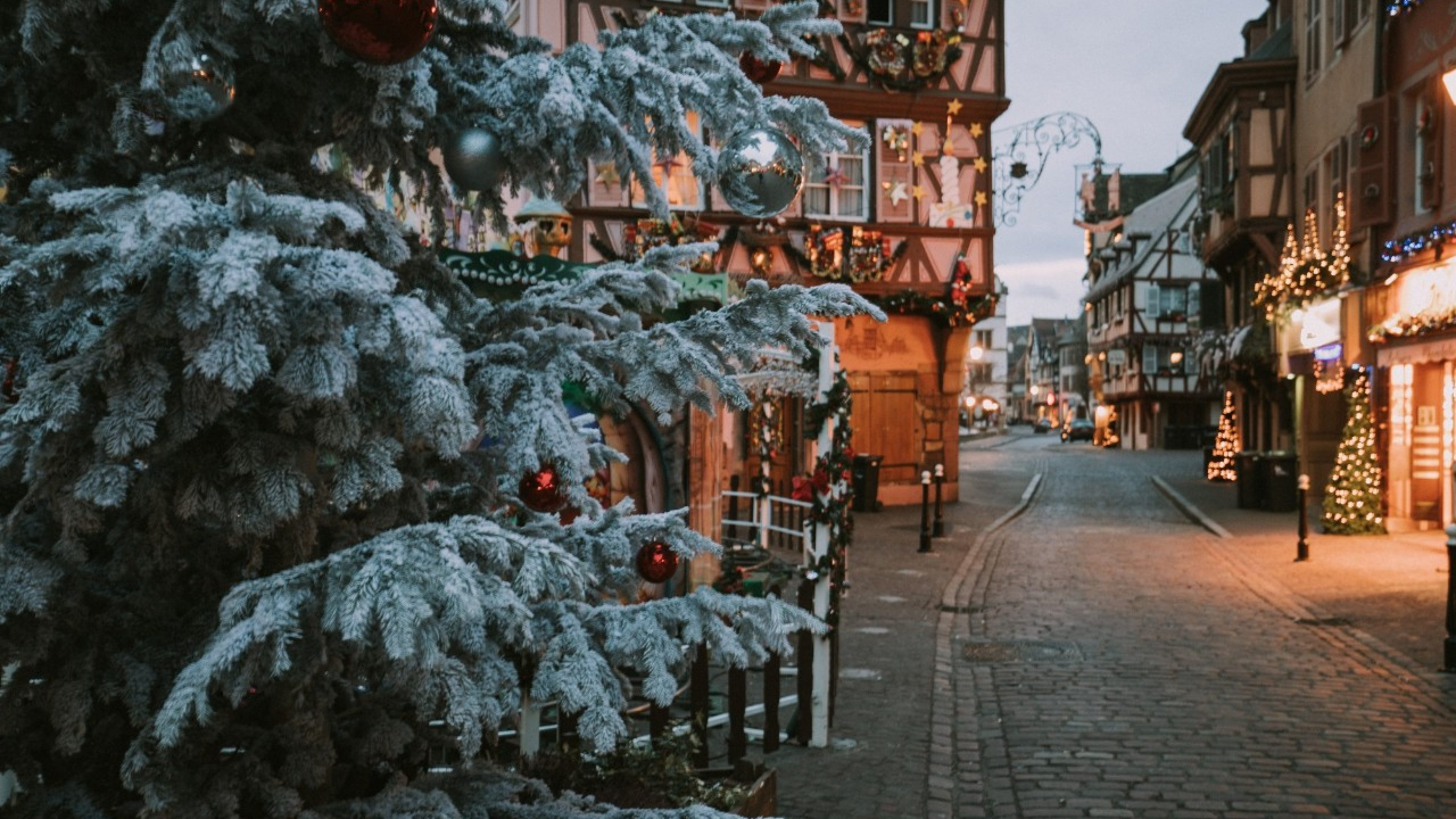 Old town illuminated and decorate magical like a fairy tale in Noel festive season at early morning time in Colmar, Alsace, France.