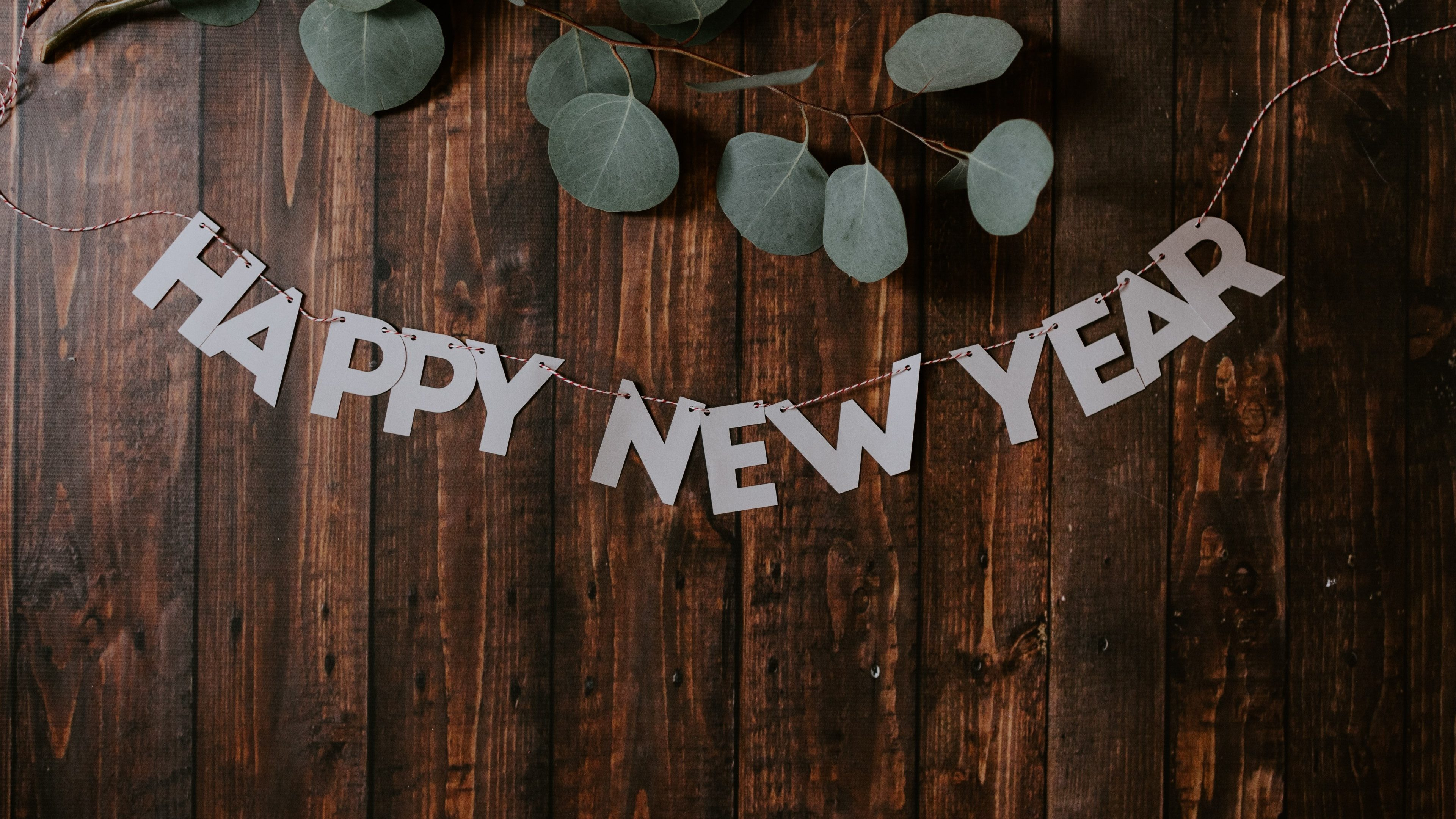 New year 2020 written on car windshield.